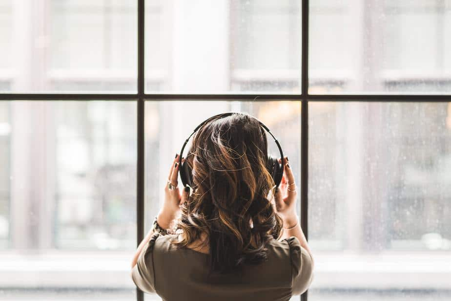 young-woman-with-headphones-wide-window