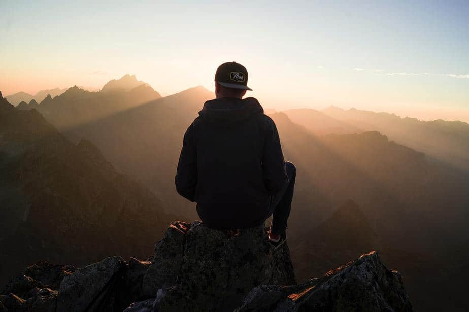 man-standing-sunrise-mountain-range